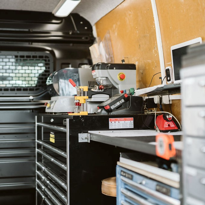 mobile locksmith vehicle with locksmith machinery in back